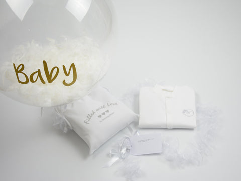 Personalised balloon and baby sleepsuit
