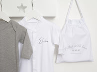 personalised white sleepsuit with gift bag