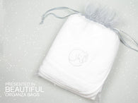 Soft cotton Snoozing Mouse hooded baby towel presented in an organza bag