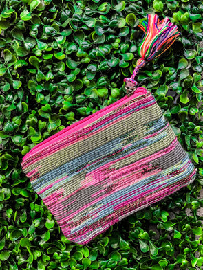 pink green and blue coin purse with tassel