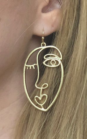 gold face earrings