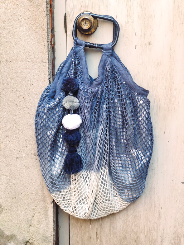 blue and silver pom pom fishnet beach bag