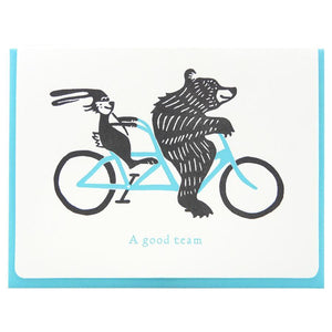 Letterpress card with bear and bunny on a tandem bike