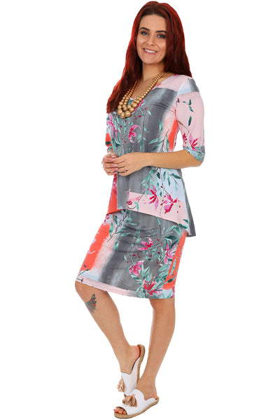 An abstract printed floral dress with a peplum at the hips, knee length finish and elbow length sleeves.