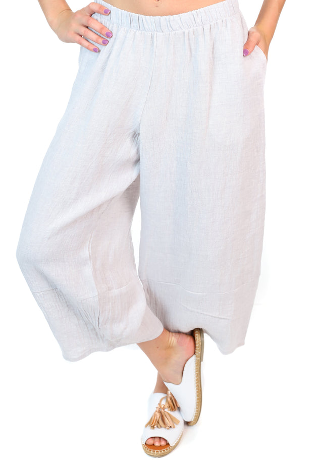 Wide leg grey linen pants with cropped legs and pockets.