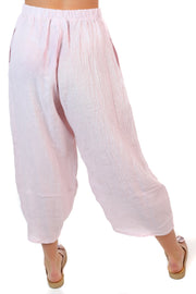 Back view of a pink pair of linen pants.