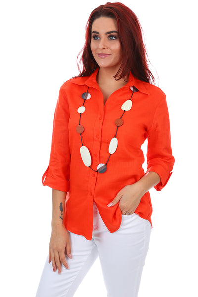 A vibrant Corsican Tab Sleeve Linen Shirt in Orange with a collar and buttons.