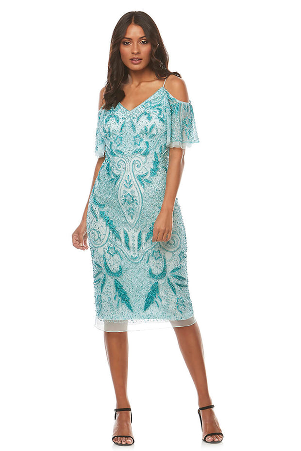 A beautifully beaded cocktail dress in mint with a short flute sleeve, soft v neckline and cold shoulder cut out.