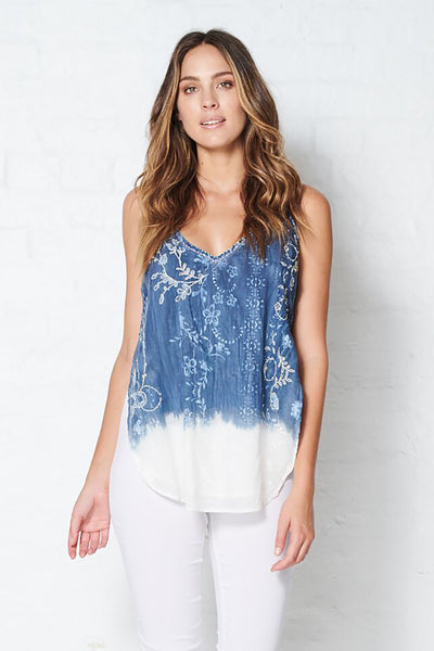 A blue cotton singlet with delicate pattern work inspired by leaves that fades down to a white dip dye hem.