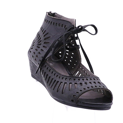 https://cdn.shopify.com/s/files/1/1218/9560/files/isabella-mayan-wedge-sandal-black.mp4