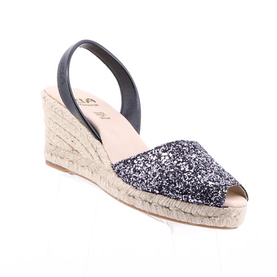 https://cdn.shopify.com/s/files/1/1218/9560/files/ria-menorca-luna-glitter-wedge-black.mp4