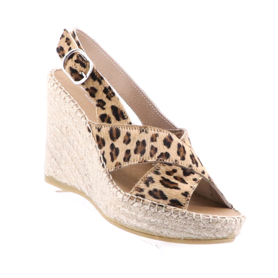 https://cdn.shopify.com/s/files/1/1218/9560/files/thenaturalshoeco-sophia-wedge-leopard.mp4