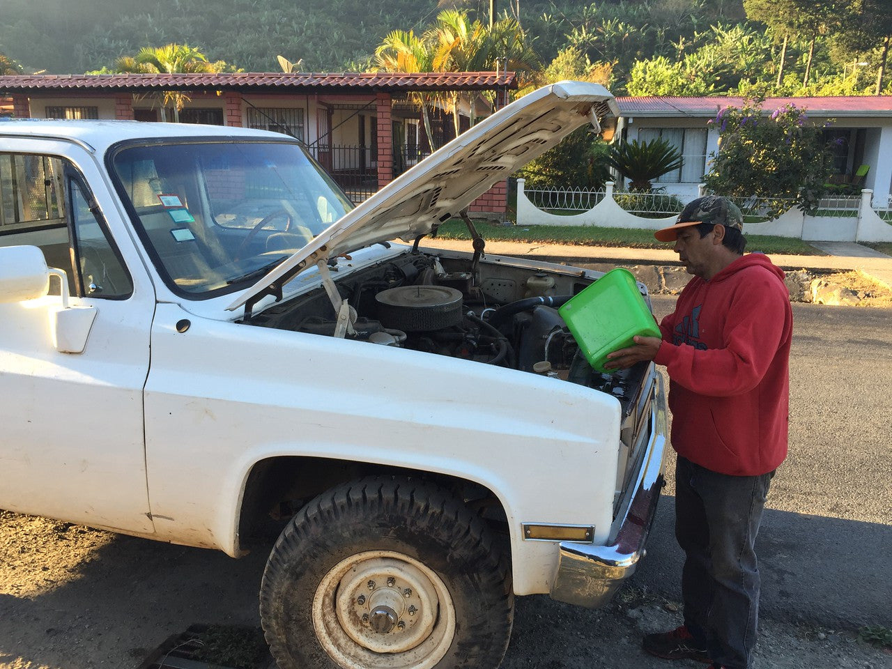 Carlos doing some maintenance on his truck