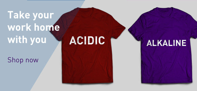Take your work home with you. Red t-shirt with the word Acidic and Purple t-shirt with the word Alkaline