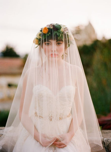 bride wearing veil and floral crown
