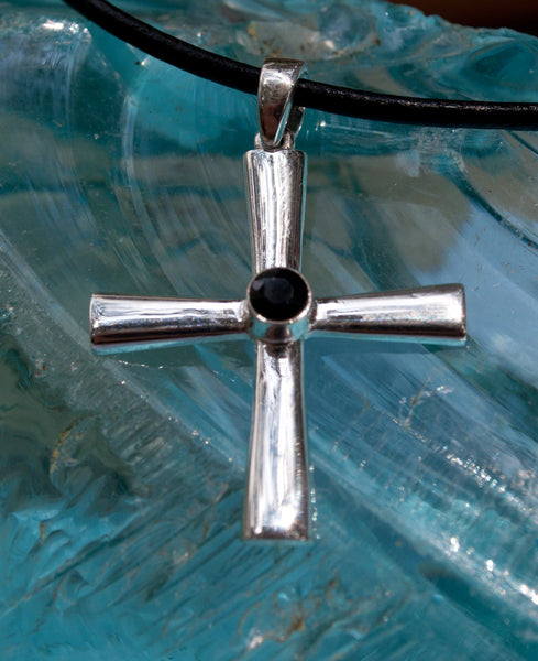 silver cross with black stone