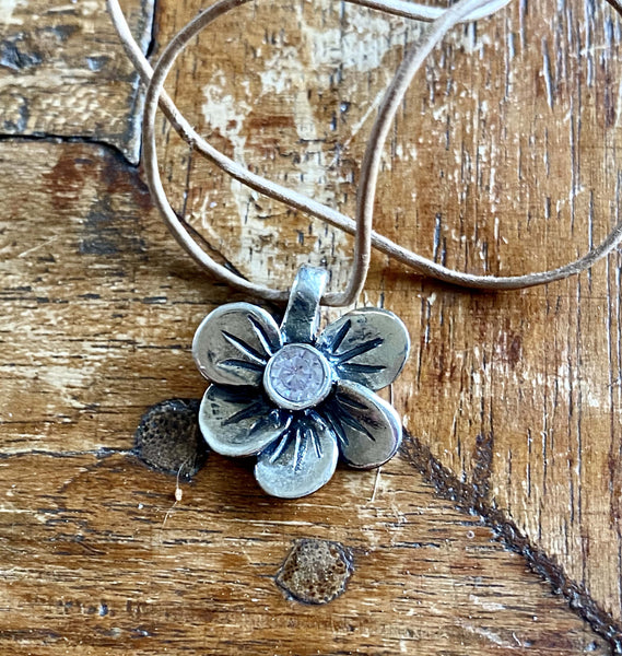 silver flower necklace with gemstone