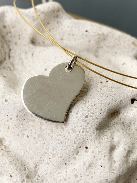 silver heart necklace on a wire