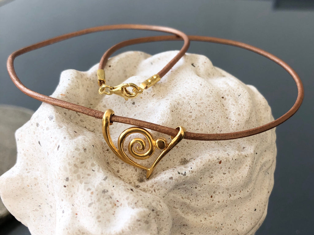 Swirl pendant gold, snail like pendant gold with brown leather necklace