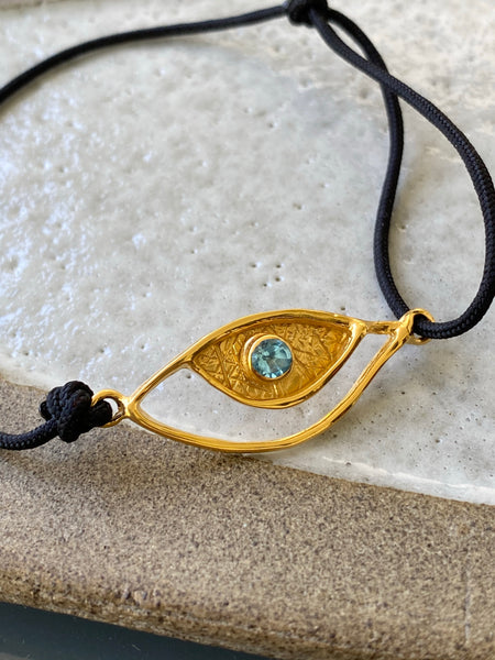 Evil eye bracelet gold, blue topaz gemstone black nylon cord