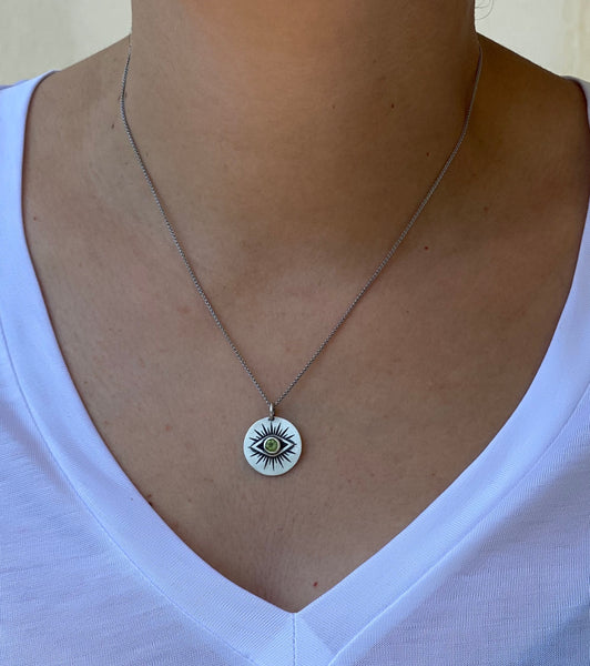 Evil eye necklace silver with a green gemstone