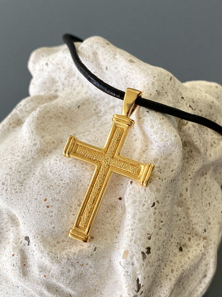 Men's gold cross necklace with leather cord