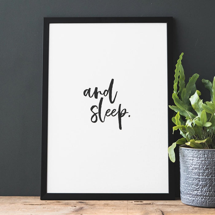 monochrome print in a black frame that reads 'and sleep'