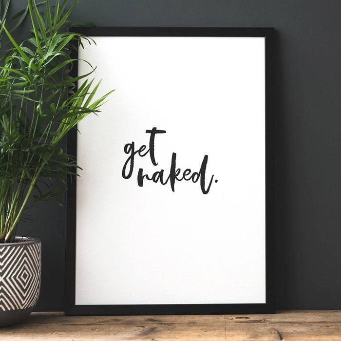 White print with black brush font in a black frame that reads 'get naked'