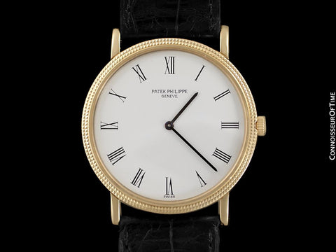 Patek Philippe Calatrava Mens Handwound Ultra Thin Watch, Ref. 3520 - 18K Gold with Hobnail Bezel
