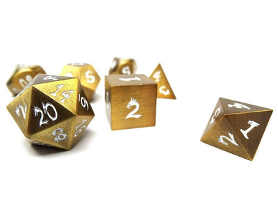 gold dice with white numbers