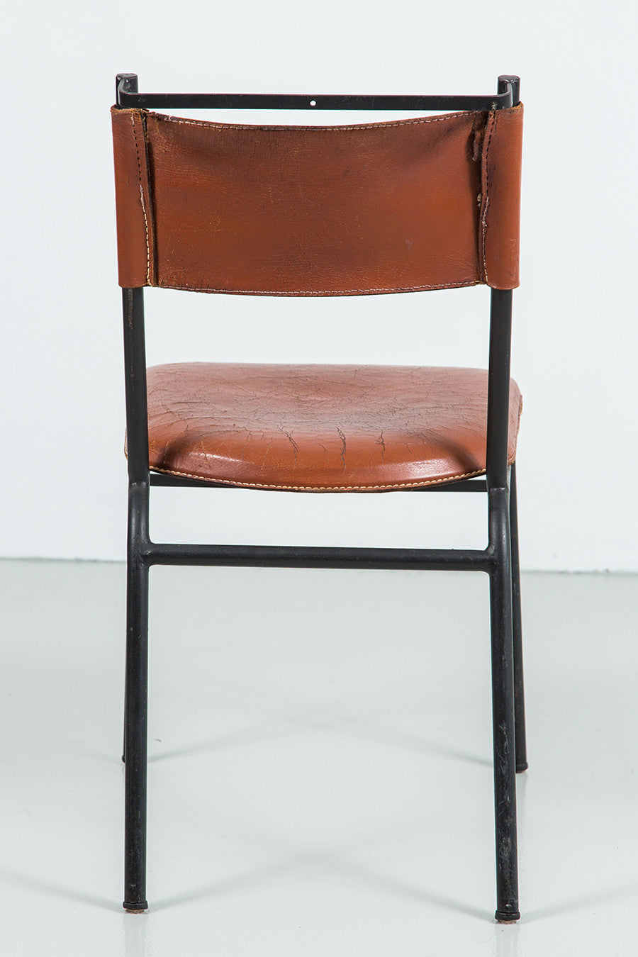Pair of Jacques Adnet Leather and Metal Dining Chairs  Pair of Jacques Adnet Leather and Metal Dining Chairs   Orange  . Dining Furniture Los Angeles. Home Design Ideas