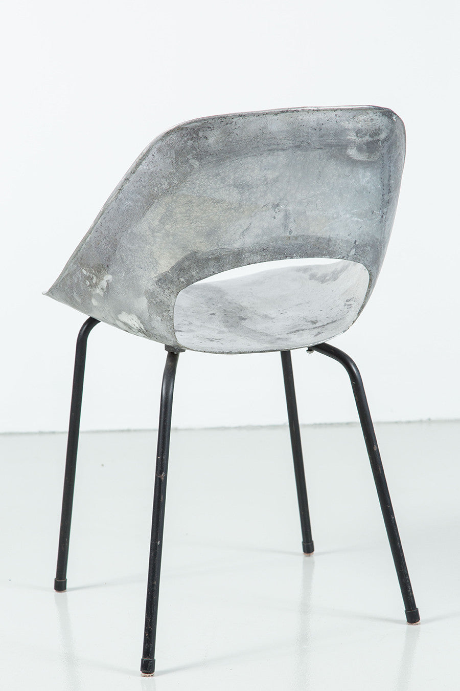 Tonneau cast aluminum chairs by pierre guariche ·