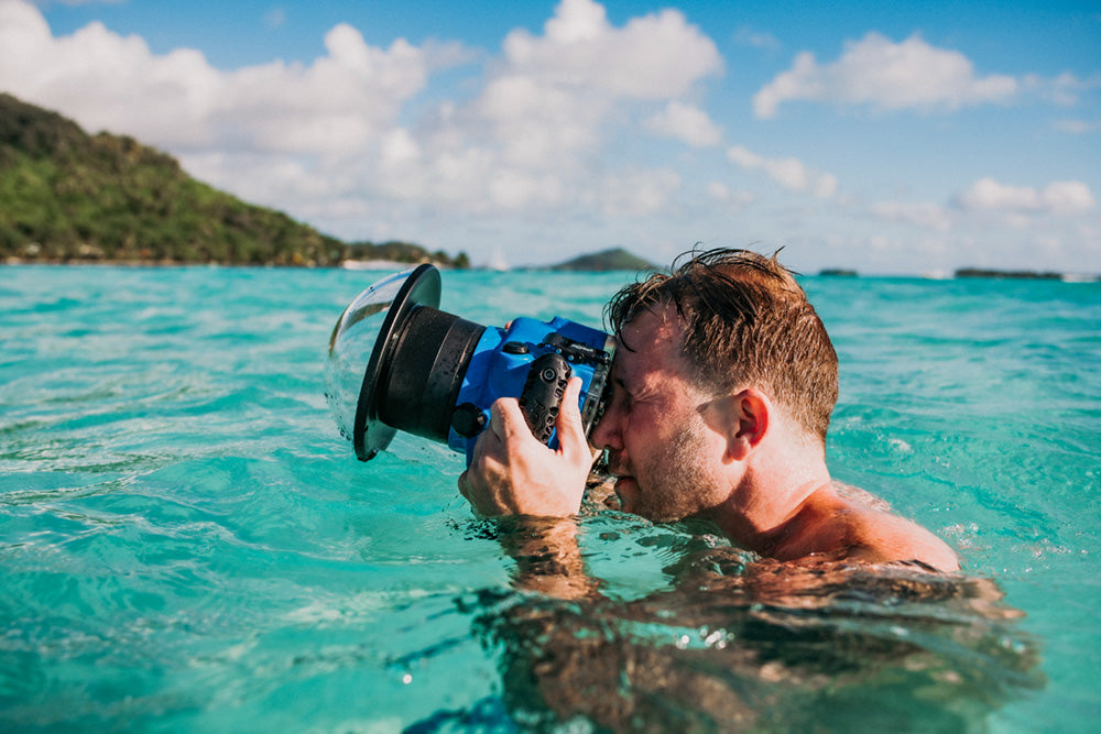 john kincaid using underwater housing in bora bora