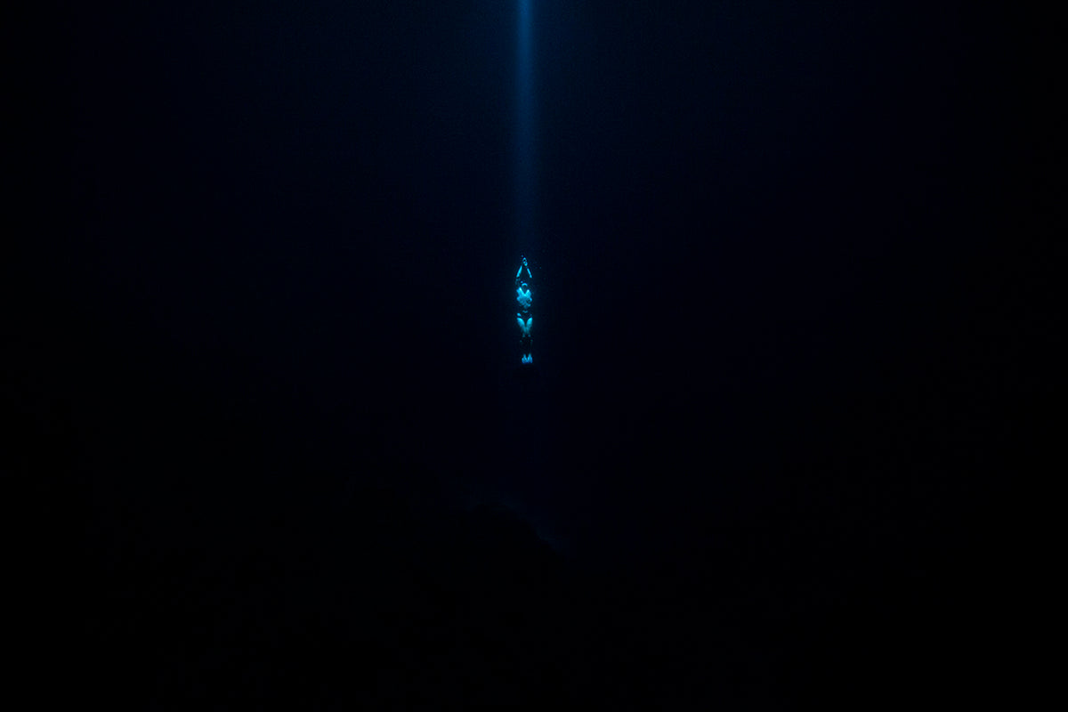 Photo of diver swimming toward the ocean surface