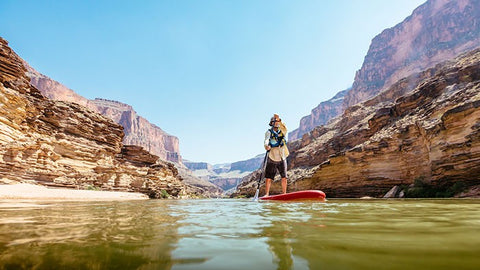 landscape shot of paddleboarding on the Colorado River