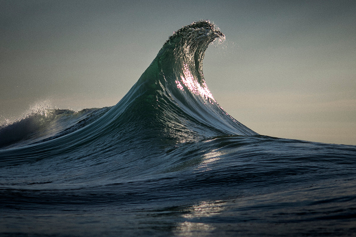 Photo of peaking ocean wave by Ray Collins