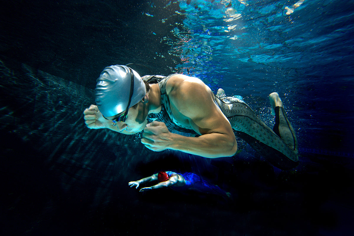 Sports photo of swimmers underwater