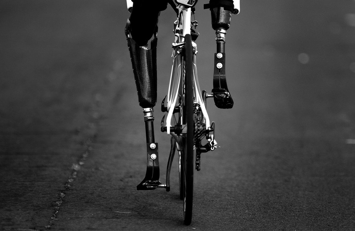 black and white image of bicyclist by Donald Miralle