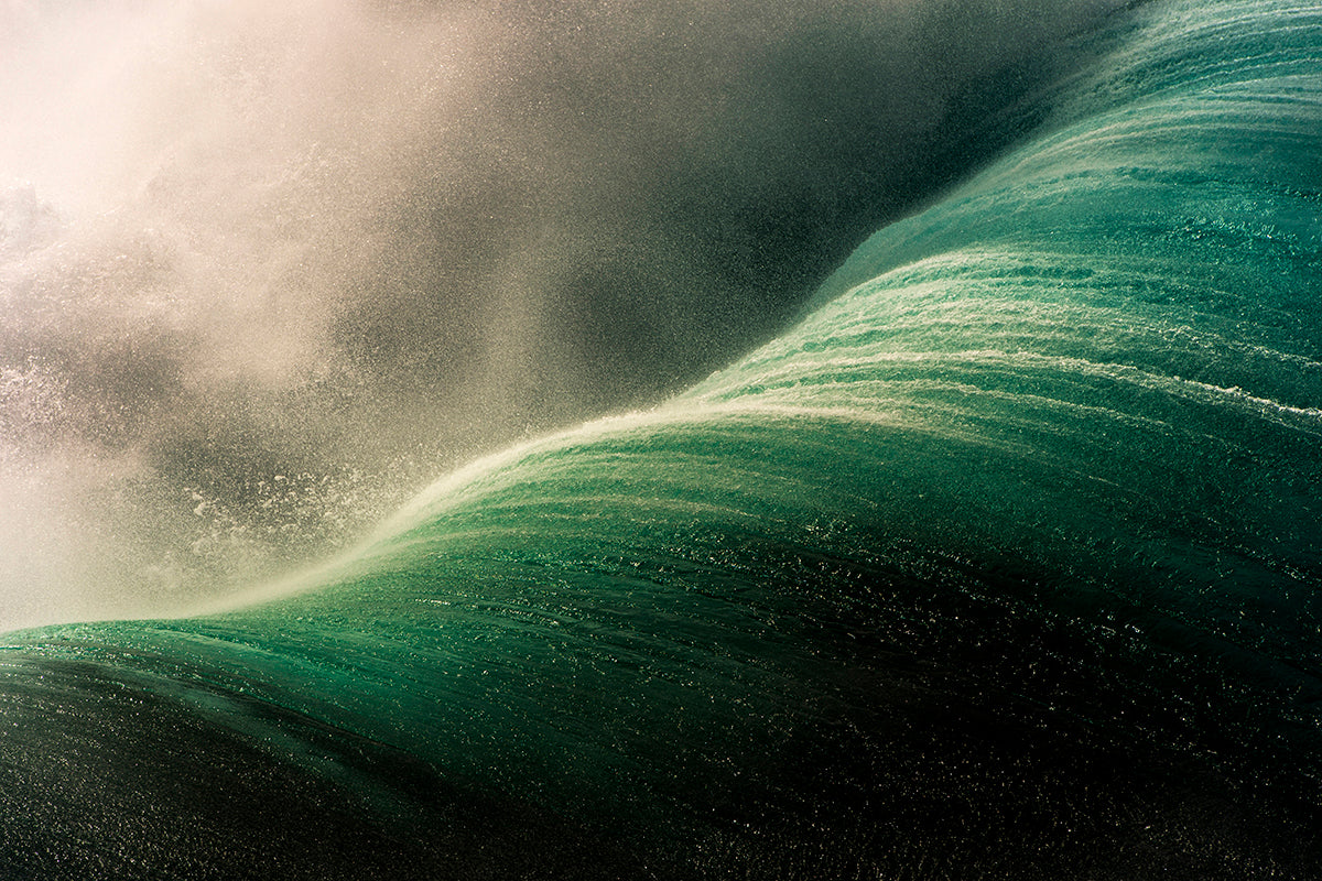 Ocean spray off of a wave photo by Ray Collins