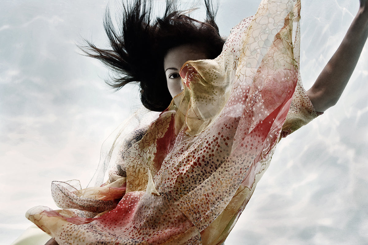 photo of a woman with windblown hair by Steve Lippman