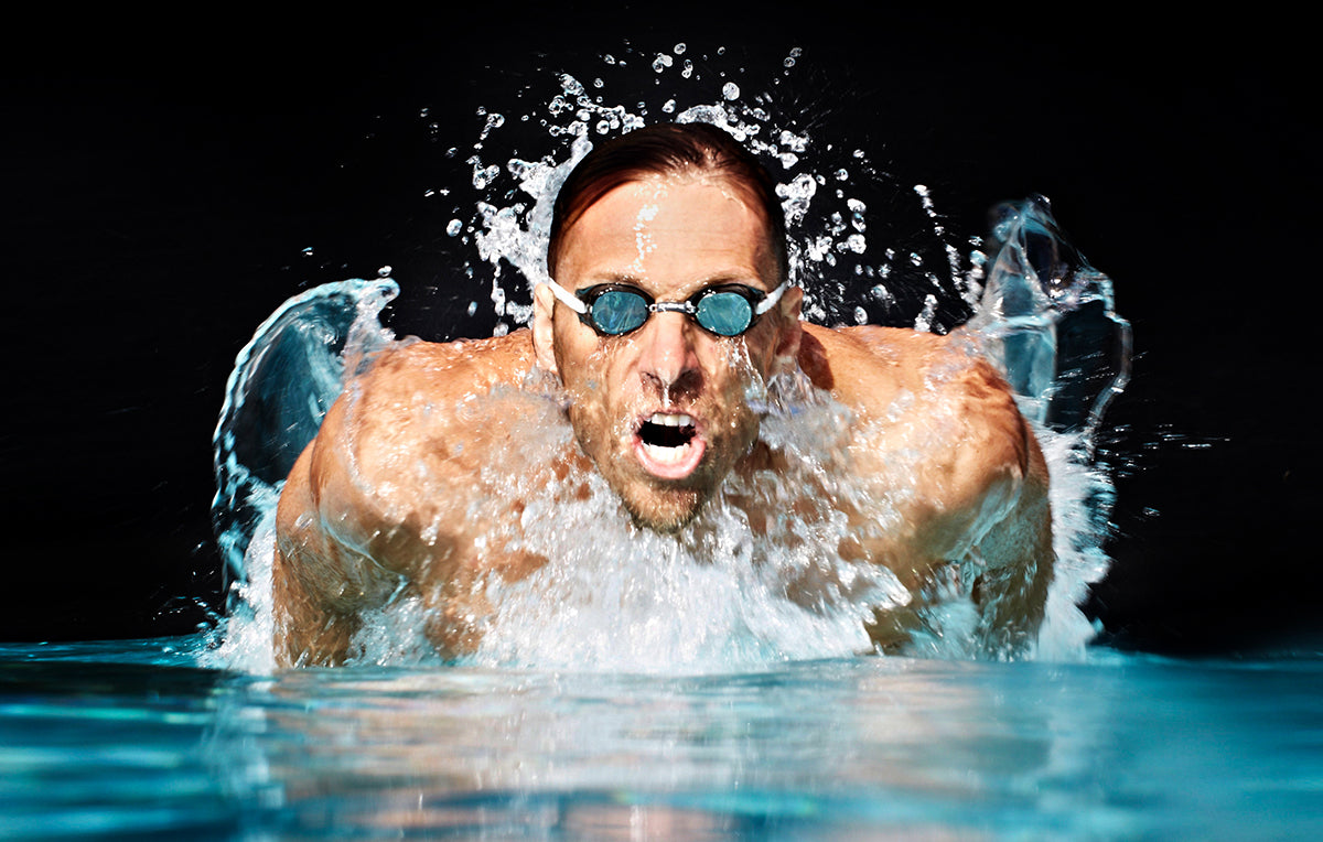 photo of a man swimming the butterfly stroke