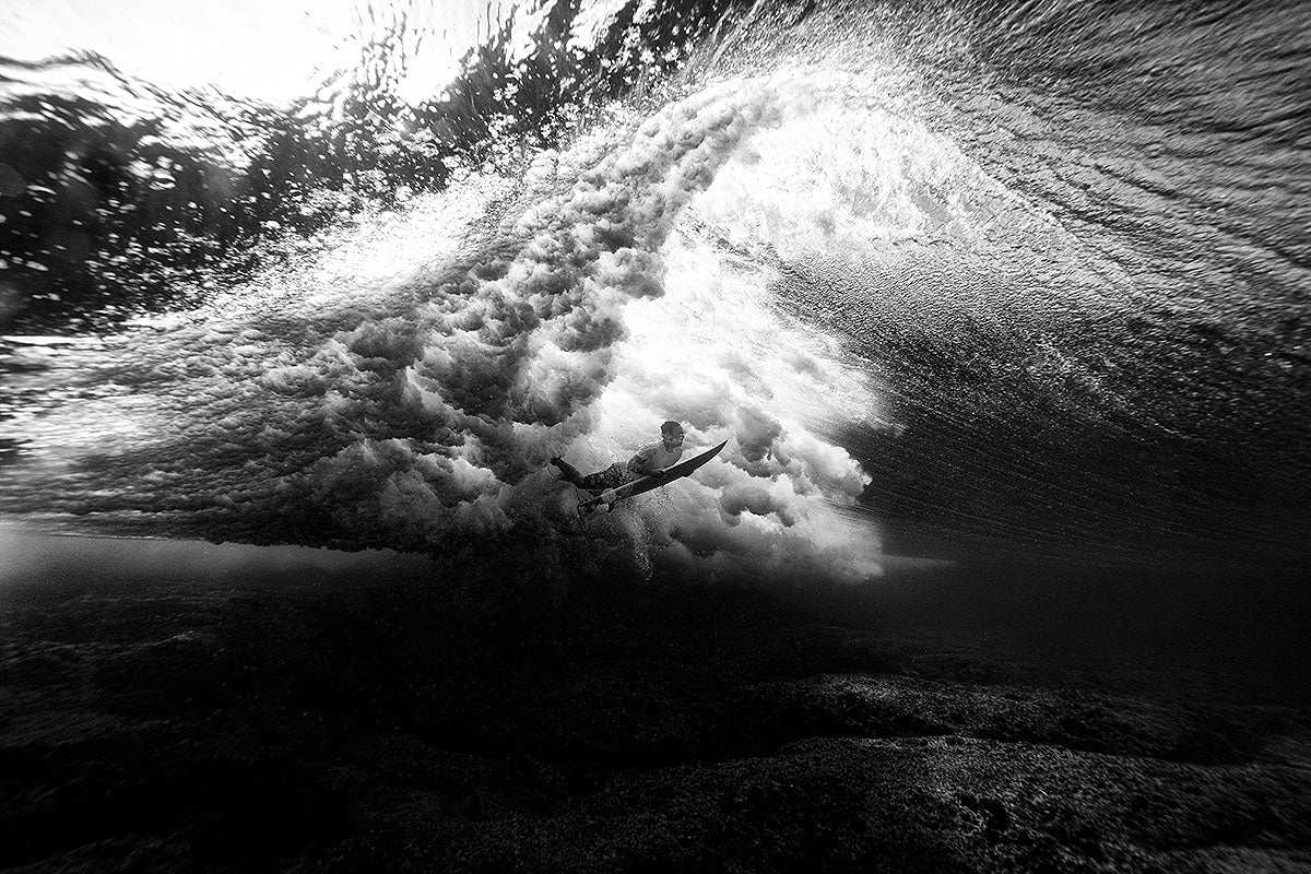 Photo of surfer duck diving by Eugene Tan