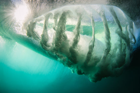 Barrel of a wave shot from underneath by Phil Thurston