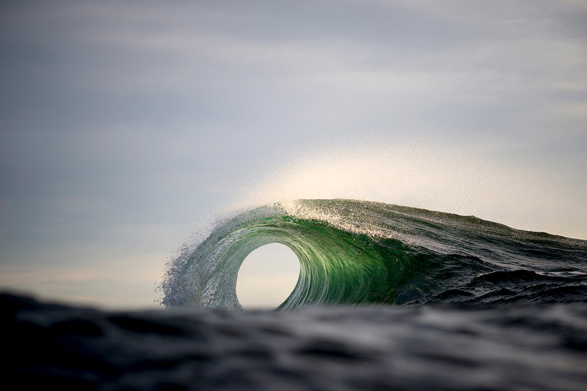 Photo of a perfect curling wave by Ray Collins