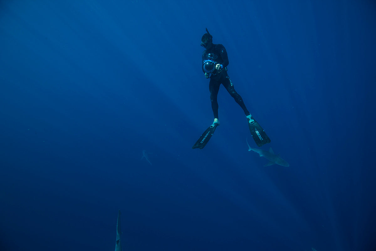photo of diver using AquaTech camera water housing and dome lens