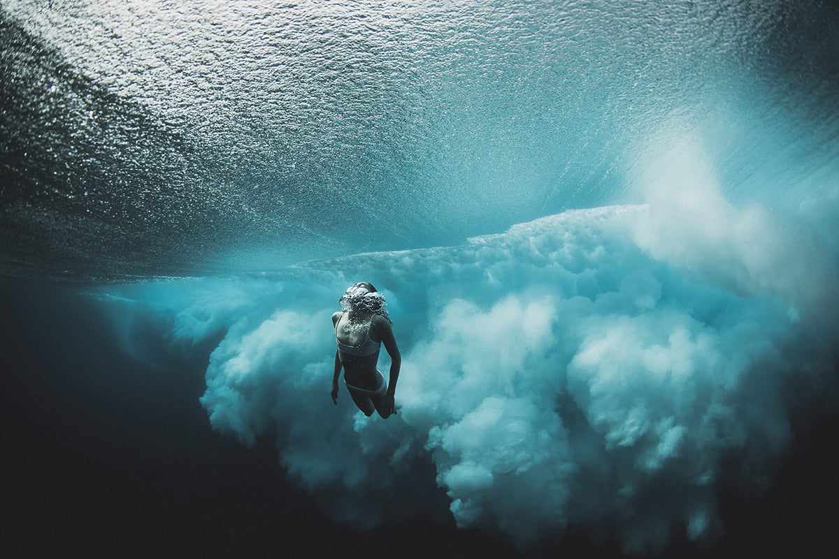 underwater photo of girl swimming by Ben Thouard