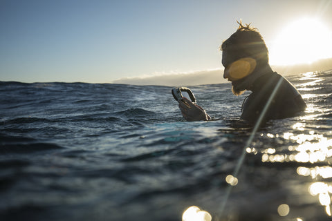 diver with iPhone housing