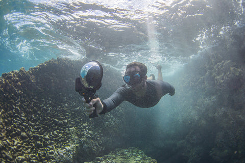 diver taking photos underwater with iPhone 7 water housing and dome port