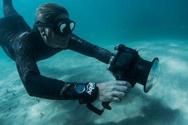 photographer under water with an AquaTech lens port