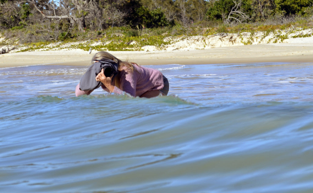 Photographer Deb Morris with underwater camera case